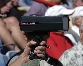 A baseball scout behind homeplate is armed with a pen and a radar gun  March 8, 2004 during  a spring training game against the Pittsburgh Pirates in Dunedin, Florida. (Photo by A. Messerschmidt/Getty Images) *** Local Caption ***
