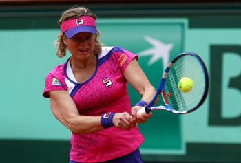 PARIS, FRANCE - MAY 26:  Kim Clijsters of Belgium hits a backhand during the women's singles round two match between Arantxa Rus of Netherlands and Kim Clijsters of Belgium on day five of the French Open at Roland Garros on May 26, 2011 in Paris, France.