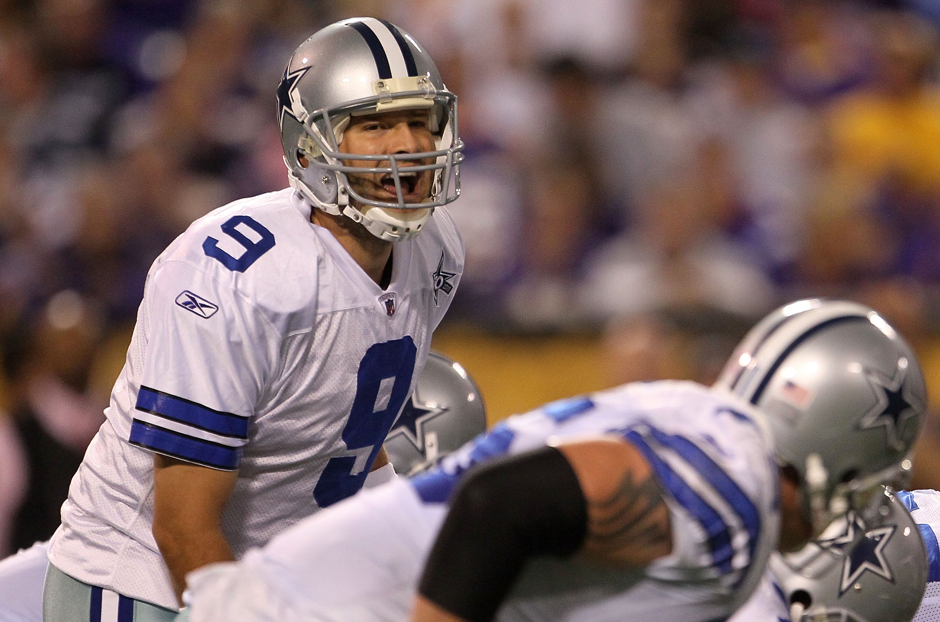 MINNEAPOLIS - OCTOBER 17:  Quarterback Tony Romo #9 of the Dallas Cowboys calls a play against the Minnesota Vikings at Mall of America Field on October 17, 2010 in Minneapolis, Minnesota.  (Photo by Jeff Gross/Getty Images)