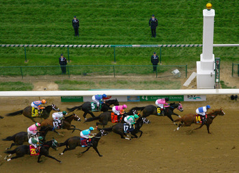 LOUISVILLE, KY - MAY 07:  The pack of horses races past the finish line during the 137th Kentucky Derby at Churchill Downs on May 7, 2011 in Louisville, Kentucky.  (Photo by Jamie Squire/Getty Images)