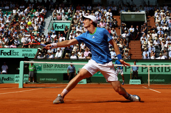PARIS, FRANCE - JUNE 03:  Andy Murray of Great Britain hits a backhand during the men's singles semi final match between Rafael Nadal of Spain and Andy Murray of Great Britain on day thirteen of the French Open at Roland Garros on June 3, 2011 in Paris, F