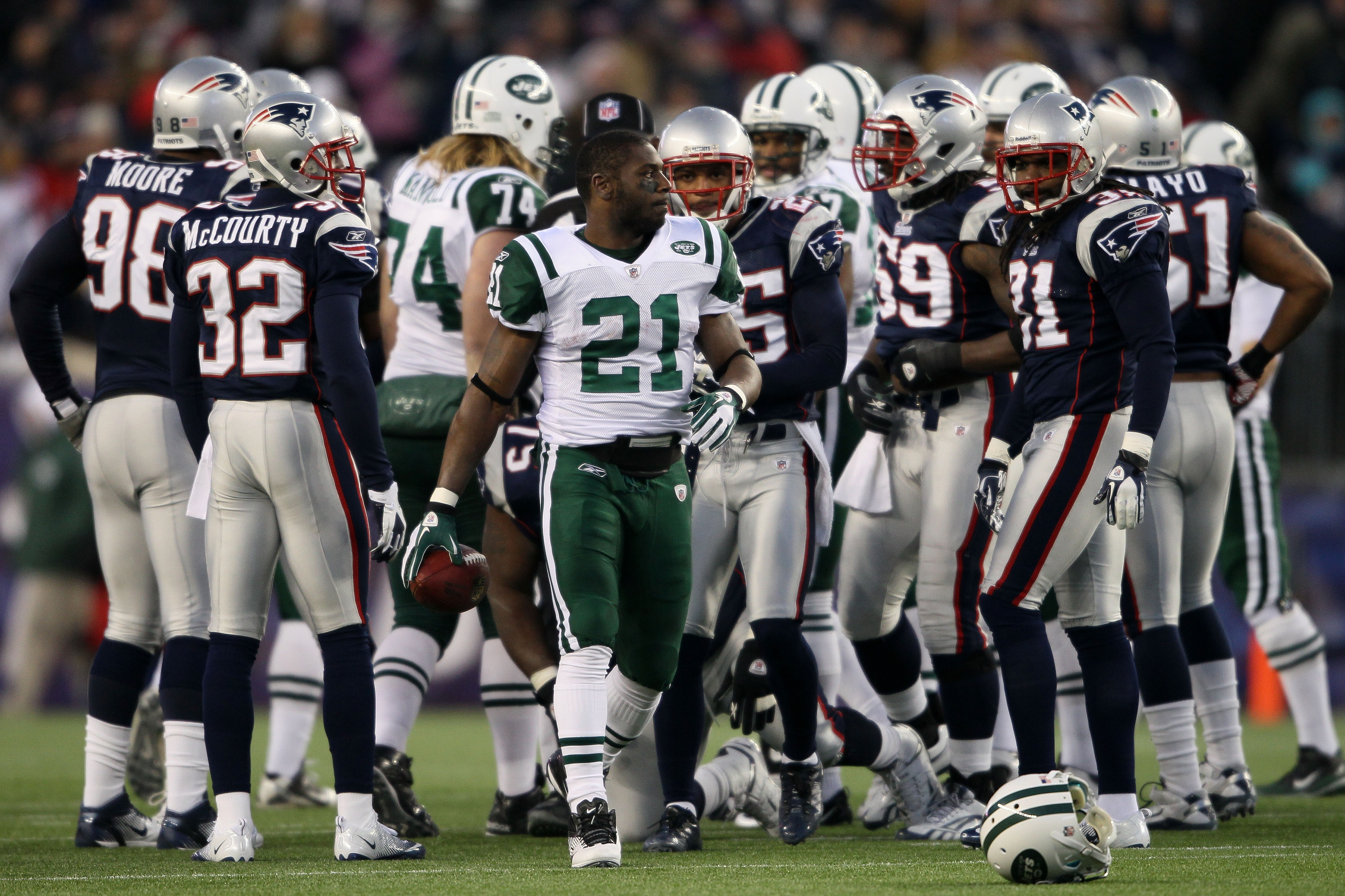 FOXBORO, MA - JANUARY 16:  Running back LaDainian Tomlinson #21 of the New York Jets walks with the ball after a play against the New England Patriots during their 2011 AFC divisional playoff game at Gillette Stadium on January 16, 2011 in Foxboro, Massac