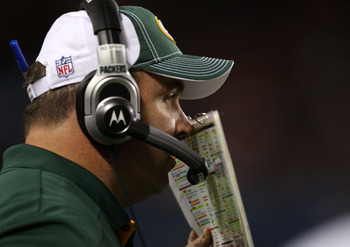 CHICAGO - SEPTEMBER 27:  Head coach Mike McCarthy of the Green Bay Packers talks into his headset against the Chicago Bears at Soldier Field on September 27, 2010 in Chicago, Illinois.  (Photo by Jonathan Daniel/Getty Images)