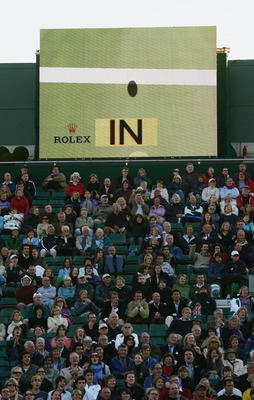 LONDON - JUNE 25:   The hawkeye system displays a decision on the screen during the Men's Singles first round match between Tim Henman of Great Britain and Carlos Moya of Spain during day one of the Wimbledon Lawn Tennis Championships at the All England L
