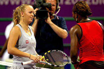 DOHA, QATAR - OCTOBER 31:  Caroline Wozniacki of Denmark retires from her match against Serena Williams of the United States during the semifinals of the Sony Ericsson WTA Championships at the Khalifa International Tennis and Squash Complex on October 31,