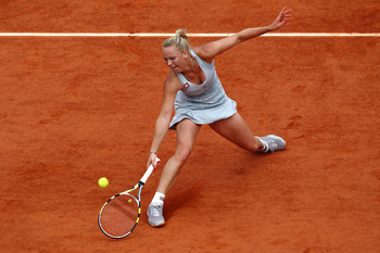 PARIS - MAY 30:  Caroline Wozniacki of Denmark plays a forehand volley during the women's singles fourth round match between Caroline Wozniacki of Denmark and Flavia Pennetta of Italy on day eight of the French Open at Roland Garros on May 30, 2010 in Par