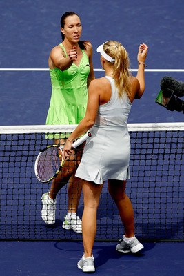INDIAN WELLS, CA - MARCH 21:  Jelena Jankovic (L) of Serbia is congratulated at the net by Caroline Wozniacki of Denmark during the final of the BNP Paribas Open on March 21, 2010 at the Indian Wells Tennis Garden in Indian Wells, California.  (Photo by M