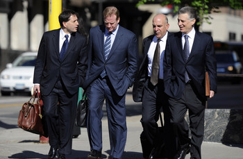 MINNEAPOLIS, MN - MAY 17: NFL lawyer Jeff Pash (L), NFL Commissioner Roger Goodell and Art Rooney II (R), president of the Pittsburgh Steelers arrive for court ordered mediation at the U.S. Courthouse on May 17, 2011 in Minneapolis, Minnesota. As the NFL