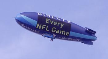 HOUSTON - NOVEMBER 28:  The DIrecTV blimp flies over Reliant Stadium on November 28, 2010 in Houston, Texas.  (Photo by Bob Levey/Getty Images)