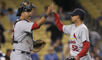 LOS ANGELES, CA - APRIL 16:  Catcher Gerald Laird #13 and closing pitcher Eduardo Sanchez #52 of the St Louis Cardinals celebrate their teams victory over the Los Angeles Dodgers at Dodger Stadium on April 16, 2011 in Los Angeles, California. The Cardinal