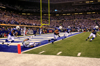 INDIANAPOLIS, IN - JANUARY 08:  Justin Tryon #20 of the Indianapolis Colts returns an interception for positive yards on a pass intended for Dustin Keller #81 of the New York Jets during the second quarter of their 2011 AFC wild card playoff game at Lucas