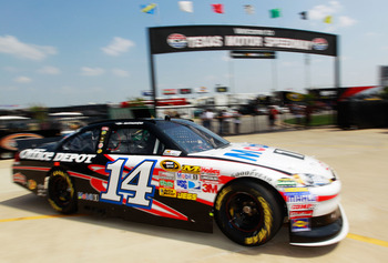 FORT WORTH, TX - APRIL 08:  Tony Stewart drives the #14 Mobil 1/Office Depot Chevrolet through the garage area during practice for the NASCAR Sprint Cup Series Samsung Mobile 500 at Texas Motor Speedway on April 8, 2011 in Fort Worth, Texas.  (Photo by To