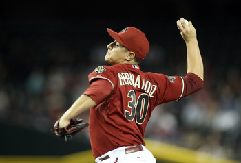 PHOENIX, AZ - MAY 18:  Relief pitcher David Hernandez #30 of the Arizona Diamondbacks pitches against the Atlanta Braves during the Major League Baseball game at Chase Field on May 18, 2011 in Phoenix, Arizona.  The Diamondbacks defeated the Braves 5-4 in