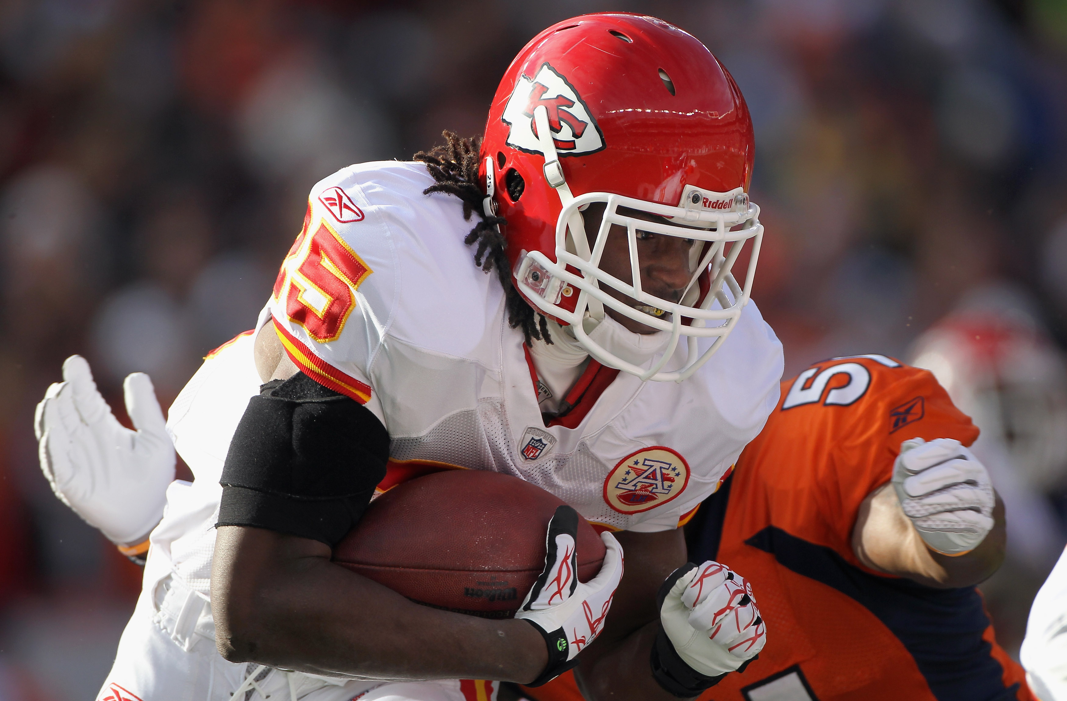 DENVER - NOVEMBER 14:  Running back Jamaal Charles #25 of the Kansas City Chiefs rushes the ball and is stopped by linebacker Joe Mays #51 of the Denver Bronco defense at INVESCO Field at Mile High on November 14, 2010 in Denver, Colorado.  (Photo by Doug