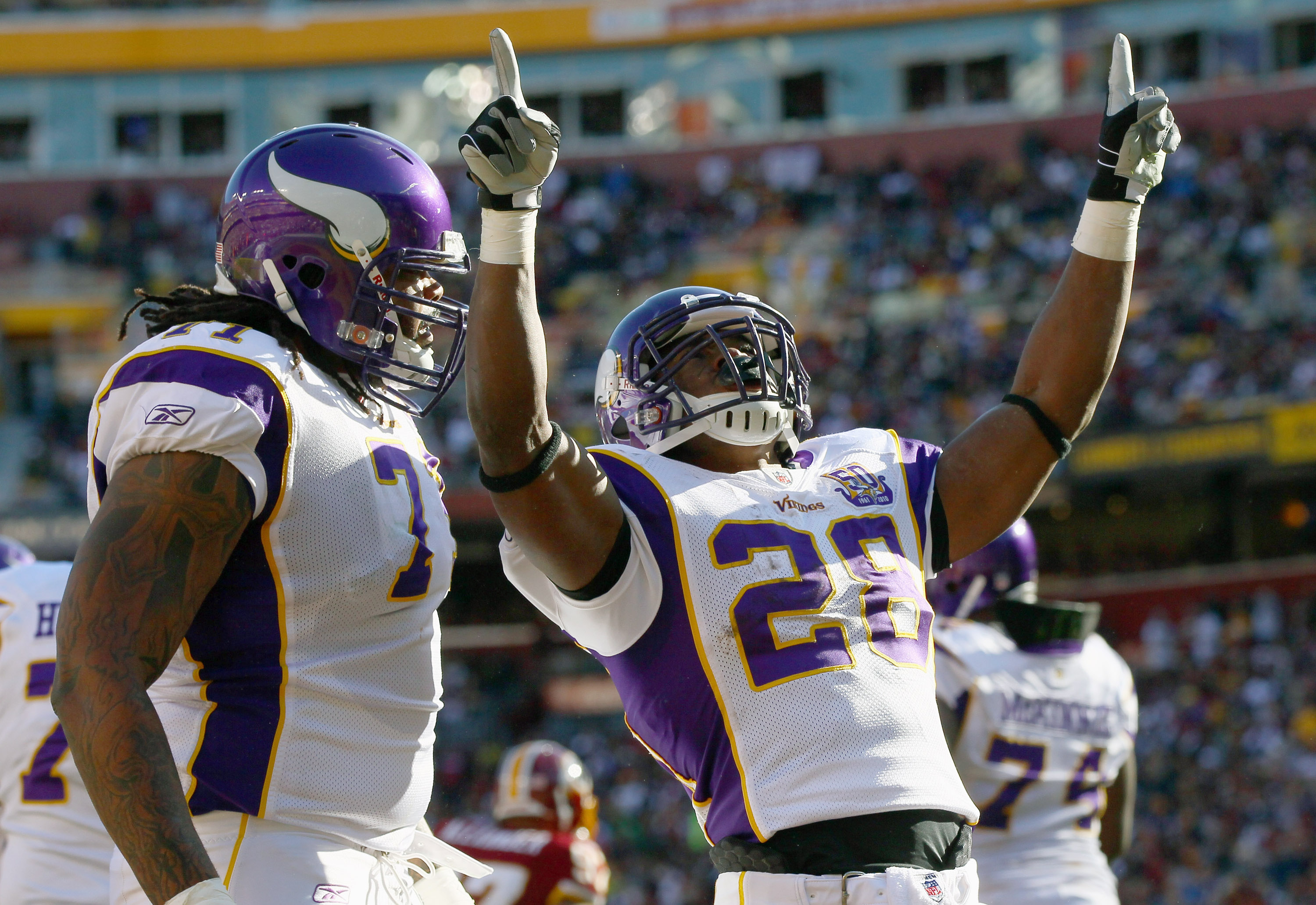 LANDOVER, MD - NOVEMBER 28:  Adrian Peterson #28 of the Minnesota Vikings celebrates after scoring a touchdown in the first quarter against the Washington Redskins at FedExField November 28, 2010 in Landover, Maryland.  (Photo by Win McNamee/Getty Images)