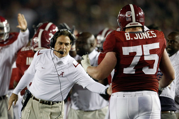 PASADENA, CA - JANUARY 07:  Head coach Nick Saban of the Alabama Crimson Tide congratulates lineman Barrett Jones #75 after a touchdown against the Texas Longhorns in the second quarter of the Citi BCS National Championship game at the Rose Bowl on Januar