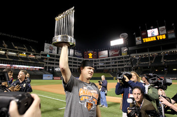 ARLINGTON, TX - NOVEMBER 01:  Matt Cain of the San Francisco Giants celebrates with the World Series Championship trophy out to the field after they won 3-1 against the Texas Rangers in Game Five of the 2010 MLB World Series at Rangers Ballpark in Arlingt