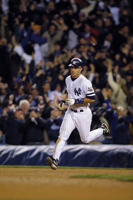 31 Oct 2001: Tino Martinez #24 of the New York Yankees circles the bases after hitting a home run against the Arizona Diamondbacks in the ninth inning during game four of the Major League Baseball World Series at Yankee Stadium in New York, New York.  The