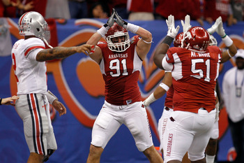 NEW ORLEANS, LA - JANUARY 04:  Jake Bequette #91 of the Arkansas Razorbacks signals a safety after stopping running back Dan Herron #1 of the Ohio State Buckeyes in the endzone in the fourth quarter during the Allstate Sugar Bowl at the Louisiana Superdom