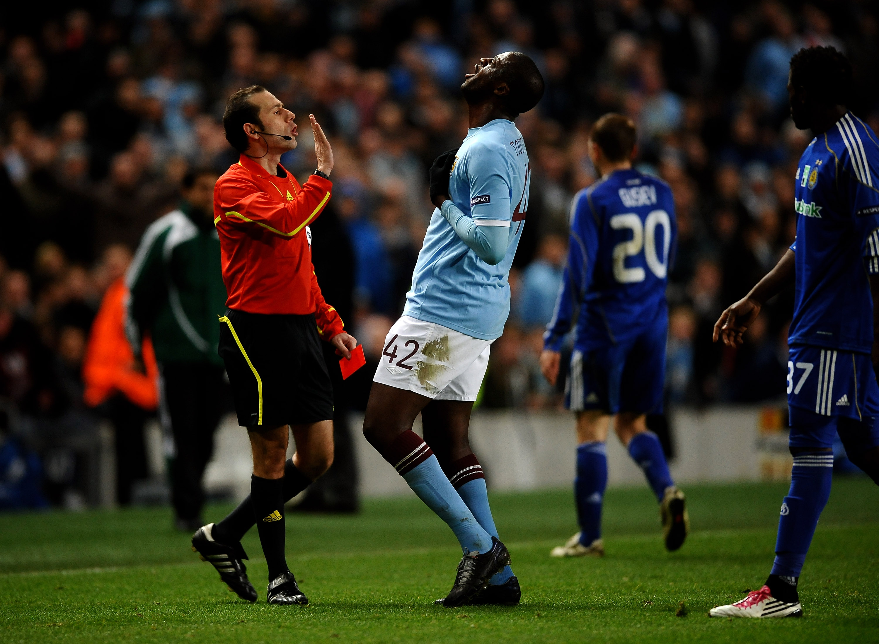 MANCHESTER, ENGLAND - MARCH 17:  Yaya Toure of Manchester City argues with referee Vladimir Sajn after he sent off Mario Balotelli of Manchester City during the UEFA Europa League round of 16 second leg match between Manchester City and Dynamo Kiev at Cit