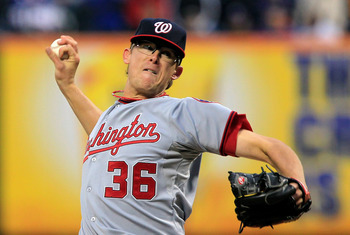 NEW YORK, NY - APRIL 08:  Tyler Clippard #36 of the Washington Nationals throws a pitch against the New York Mets during the Mets' Home Opener at Citi Field on April 8, 2011 in the Flushing neighborhood of Queens in New York City. The Nationals won 6-2.