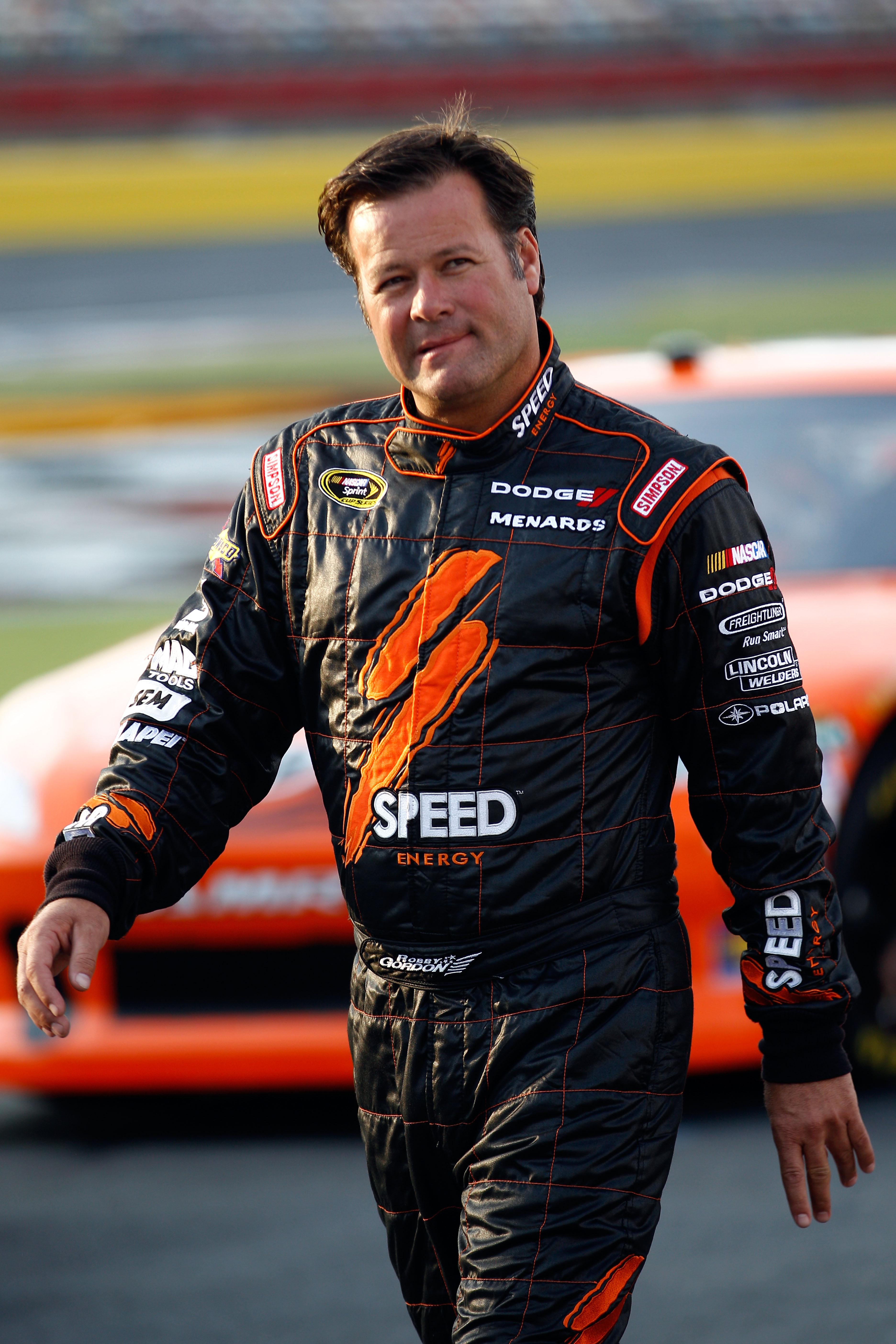 CHARLOTTE, NC - MAY 26:  Robby Gordon, driver of the #7 Speed Energy Dodge, walks on the grid during qualifying for the NASCAR Sprint Cup Series Coca-Cola 600 at Charlotte Motor Speedway on May 26, 2011 in Charlotte, North Carolina.  (Photo by Chris Grayt