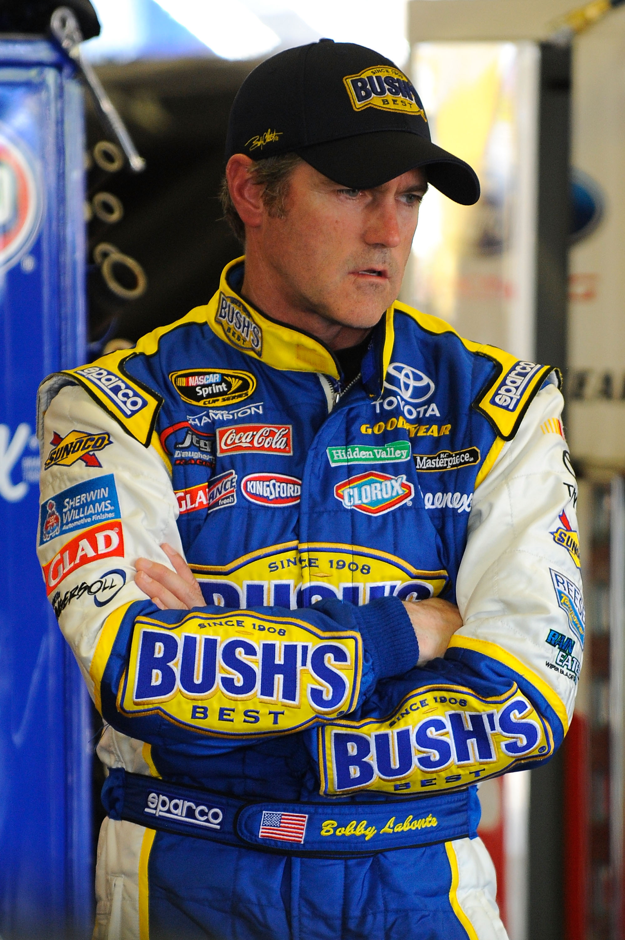 FORT WORTH, TX - APRIL 07:  Bobby Labonte, driver of the #47 Bush's Baked Beans Toyota, stands in the garage area during practice for the NASCAR Sprint Cup Series Samsung Mobile 500 at Texas Motor Speedway on April 7, 2011 in Fort Worth, Texas.  (Photo by