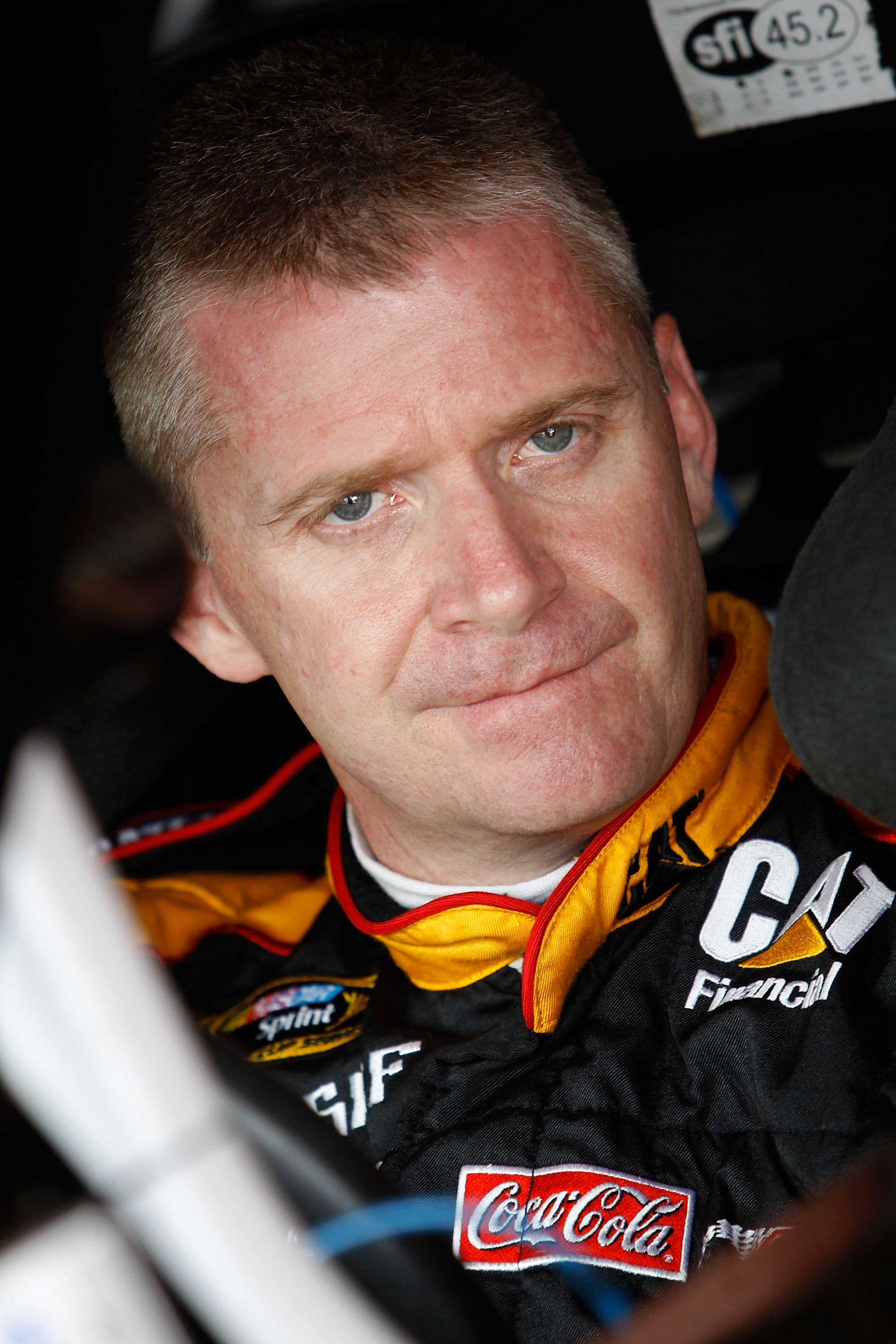 KANSAS CITY, KS - JUNE 03:  Jeff Burton, driver of the #31 Caterpillar Chevrolet, sits in his car in the garage area during practice for the NASCAR Sprint Cup Series STP 400 at Kansas Speedway on June 3, 2011 in Kansas City, Kansas.  (Photo by Todd Warsha