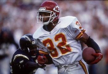 Kansas City Chiefs running back Marcus Allen races around the end on for a key 18 yard gain to the one yard line, setting up the winning touchdown, during the Chiefs'' 17-14 come from behind victory over the San Diego Chargers at San Diego Jack Murphy Sta