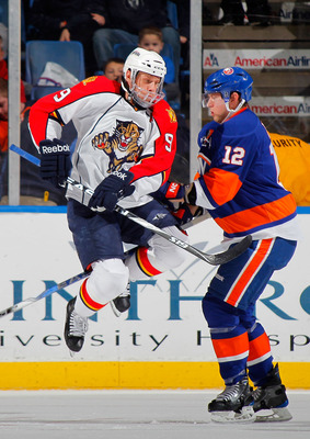 UNIONDALE, NY - NOVEMBER 20:  Stephen Weiss #9 of the Florida Panthers tries to leap out of the way of a slapshot from the point as Josh Bailey #12 of the New York Islanders defends during the second period of a hockey game at the Nassau Coliseum on Novem