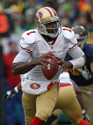 GREEN BAY, WI - DECEMBER 05: Troy Smith #1 of the San Francisco 49ers rolls out to look for a receiver against the Green Bay Packers at Lambeau Field on December 5, 2010 in Green Bay, Wisconsin. The Packers defeated the 49ers 34-16. (Photo by Jonathan Dan