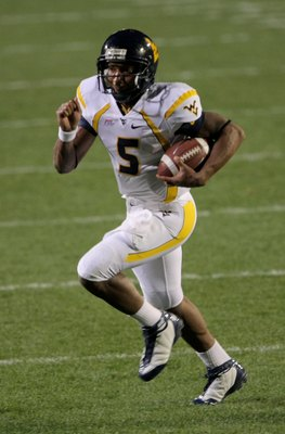 BOULDER, CO - SEPTEMBER 18:  Quarterback Pat White #5 of the West Virginia Mountaineers rushes against the Colorado Buffaloes at Folsom Field on September 18, 2008 in Boulder, Colorado. Colorado defeated West Virginia 17-14 in overtime.  (Photo by Doug Pe