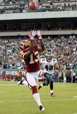 PHILADELPHIA - OCTOBER 03:  Anthony Armstrong #13 of the Washington Redskins makes a long reception against Kurt Coleman #42 of the Philadelphia Eagles on October 3, 2010 at Lincoln Financial Field in Philadelphia, Pennsylvania.  (Photo by Jim McIsaac/Get