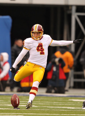 EAST RUTHERFORD, NJ - DECEMBER 05: Graham Gano #4 of the Washington Redskins kicks the ball against the New York Giants during their game on December 5, 2010 at The New Meadowlands Stadium in East Rutherford, New Jersey.  (Photo by Al Bello/Getty Images)