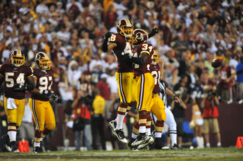 LANDOVER - SEPTEMBER 12:  Byron Westbrook #34 and Chris Horton #45 of the Washington Redskins celebrate a play during the NFL season opener against the Dallas Cowboys at FedExField on September 12, 2010 in Landover, Maryland. The Redskins defeated the Cow