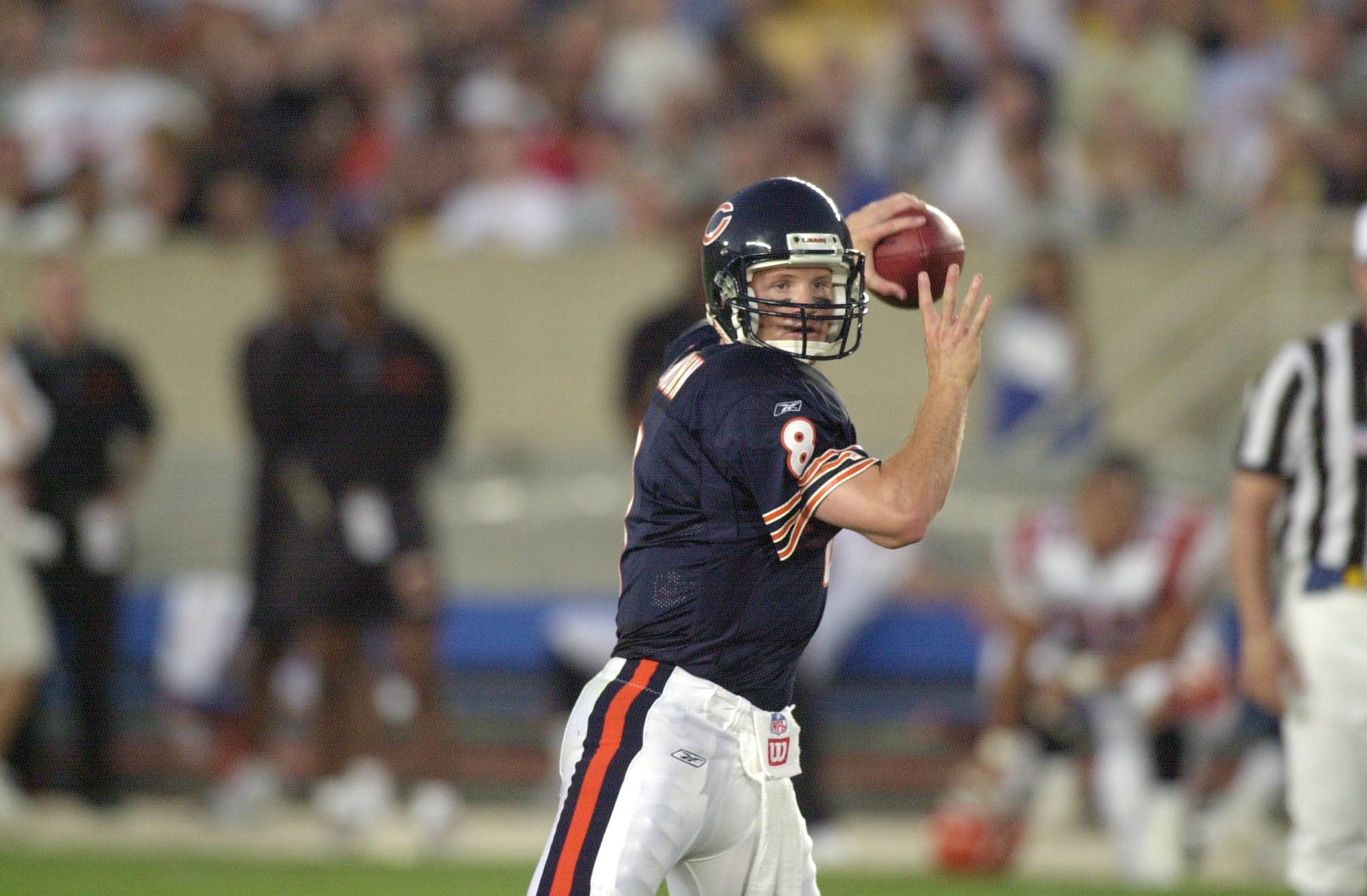 04 Aug 2001:  Cade McNown #8 of the Chicago Bears looks for the open man during the NFL pre-season game against the Cincinnati Bengals at Soldier Field in Chicago, IL. The Bears defeated the Bengals 16-13 in overtime. DIGITAL IMAGE Mandatory Credit: Jonat