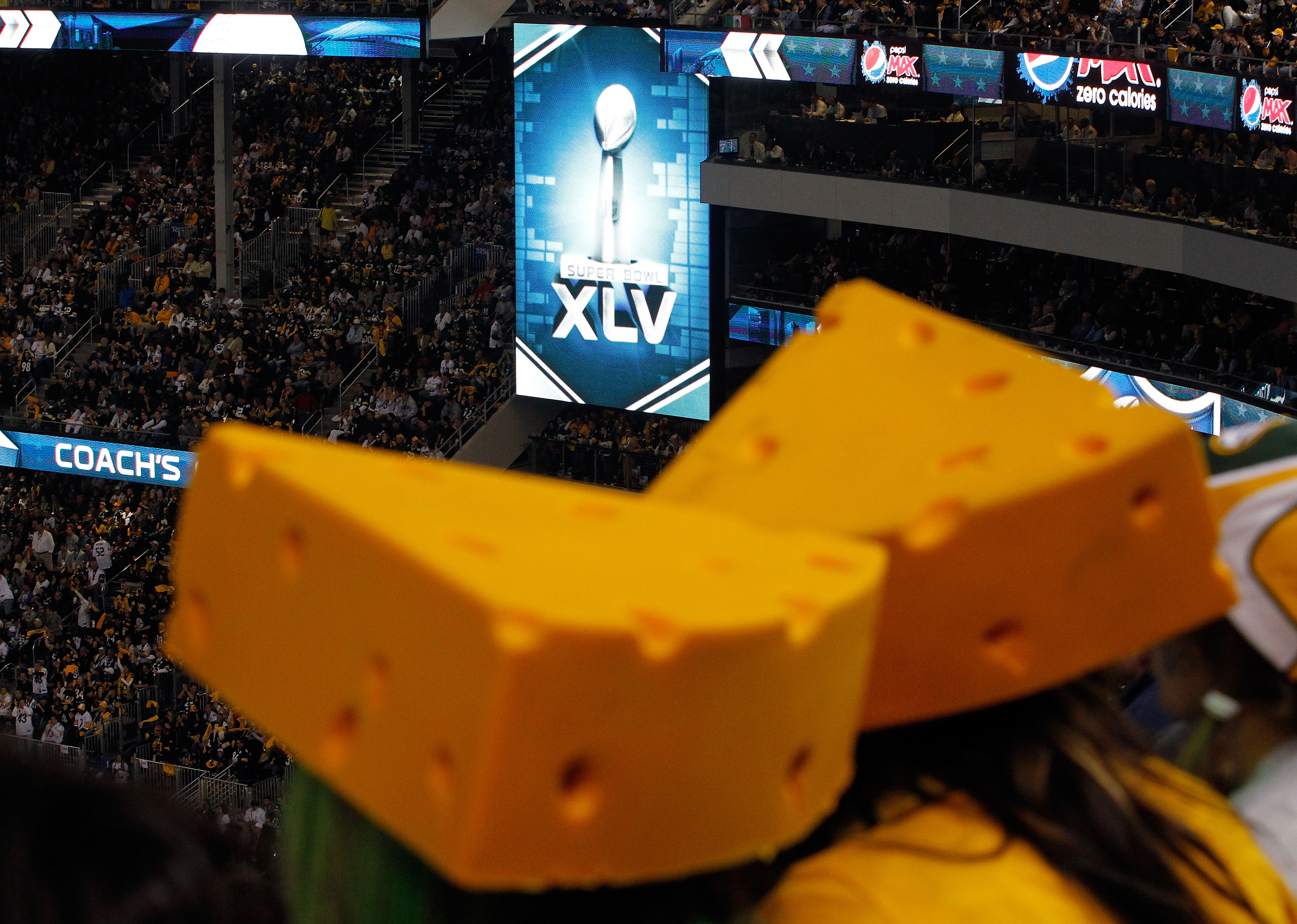 ARLINGTON, TX - FEBRUARY 06:  A general view of two cheeseheads worn by Green Bay Packers fans as the Packers take on the Pittsburgh Steelers during Super Bowl XLV at Cowboys Stadium on February 6, 2011 in Arlington, Texas.  (Photo by Tom Pennington/Getty