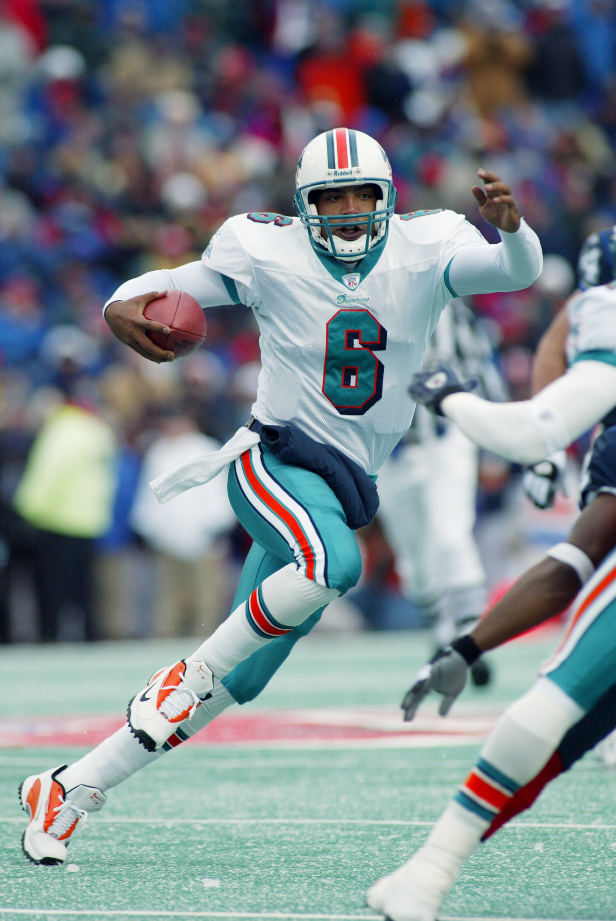 ORCHARD PARK, NY - DECEMBER 1:  Quarterback Ray Lucas #6 the Miami Dolphins scrambles during the game against the Buffalo Bills on December 1, 2002 at Ralph Wilson Stadium in Orchard Park, New York.Buffalo defeated the dolphins 38-21. (Photo by Rick Stewa