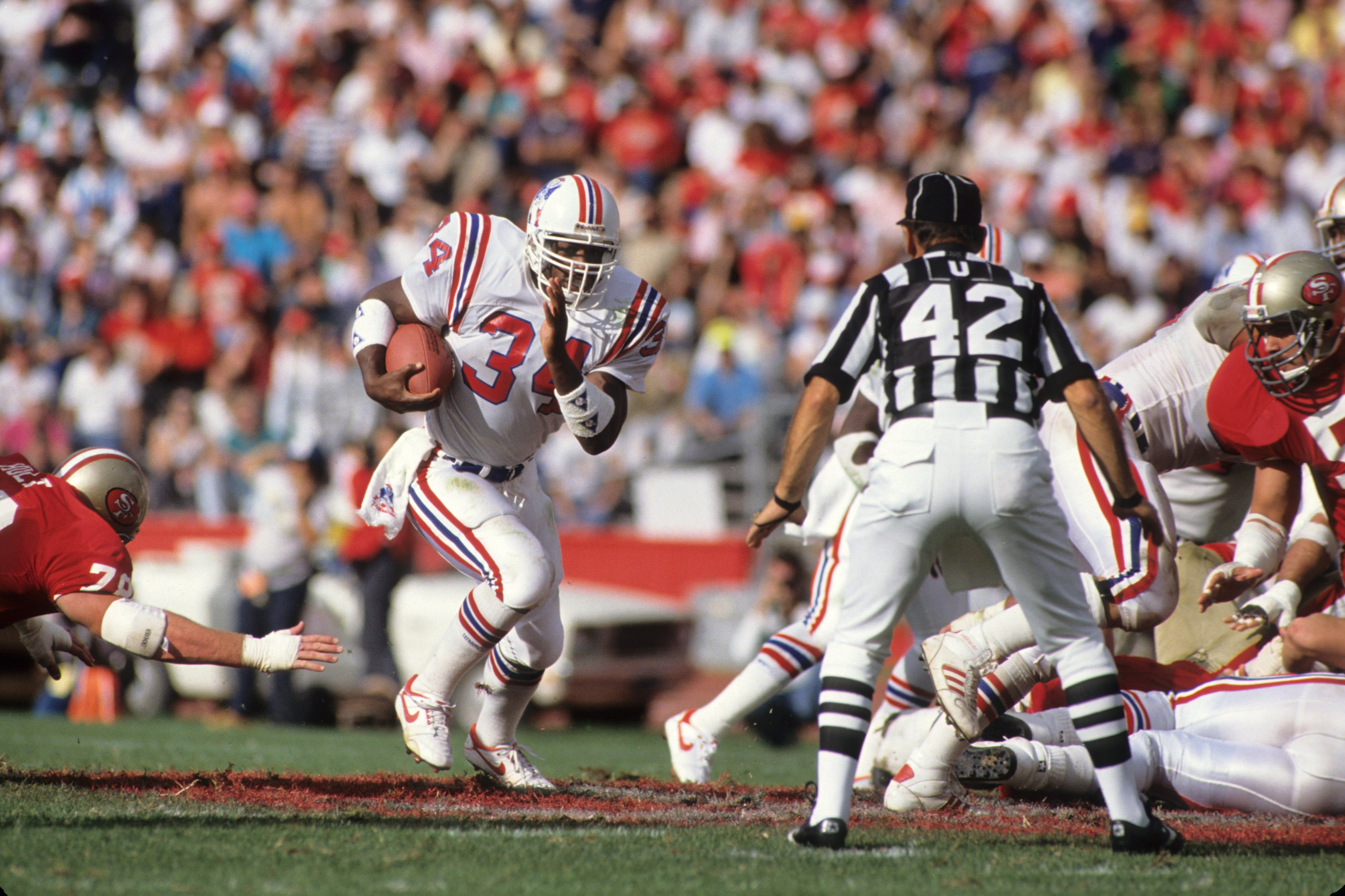 SAN FRANCISCO, CA - OCTOBER 22:  Robert Perryman #34 of New England Patriots runs with the ball during the game against the San Francisco 49ers at Candlestick Park on October 22, 1989 in San Francisco, California.  The 49ers won 37-20.  (Photo by George R