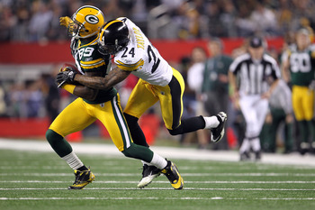 ARLINGTON, TX - FEBRUARY 06:  James Jones #89 of the Green Bay Packers runs for yards after the catch against Ike Taylor #24 of the Pittsburgh Steelers during Super Bowl XLV at Cowboys Stadium on February 6, 2011 in Arlington, Texas.  (Photo by Jamie Squi