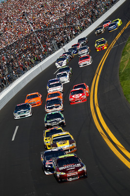 DAYTONA BEACH, FL - FEBRUARY 20:  Jeff Gordon, driver of the #24 Drive to End Hunger Chevrolet, leads a pack of cars during the NASCAR Sprint Cup Series Daytona 500 at Daytona International Speedway on February 20, 2011 in Daytona Beach, Florida.  (Photo