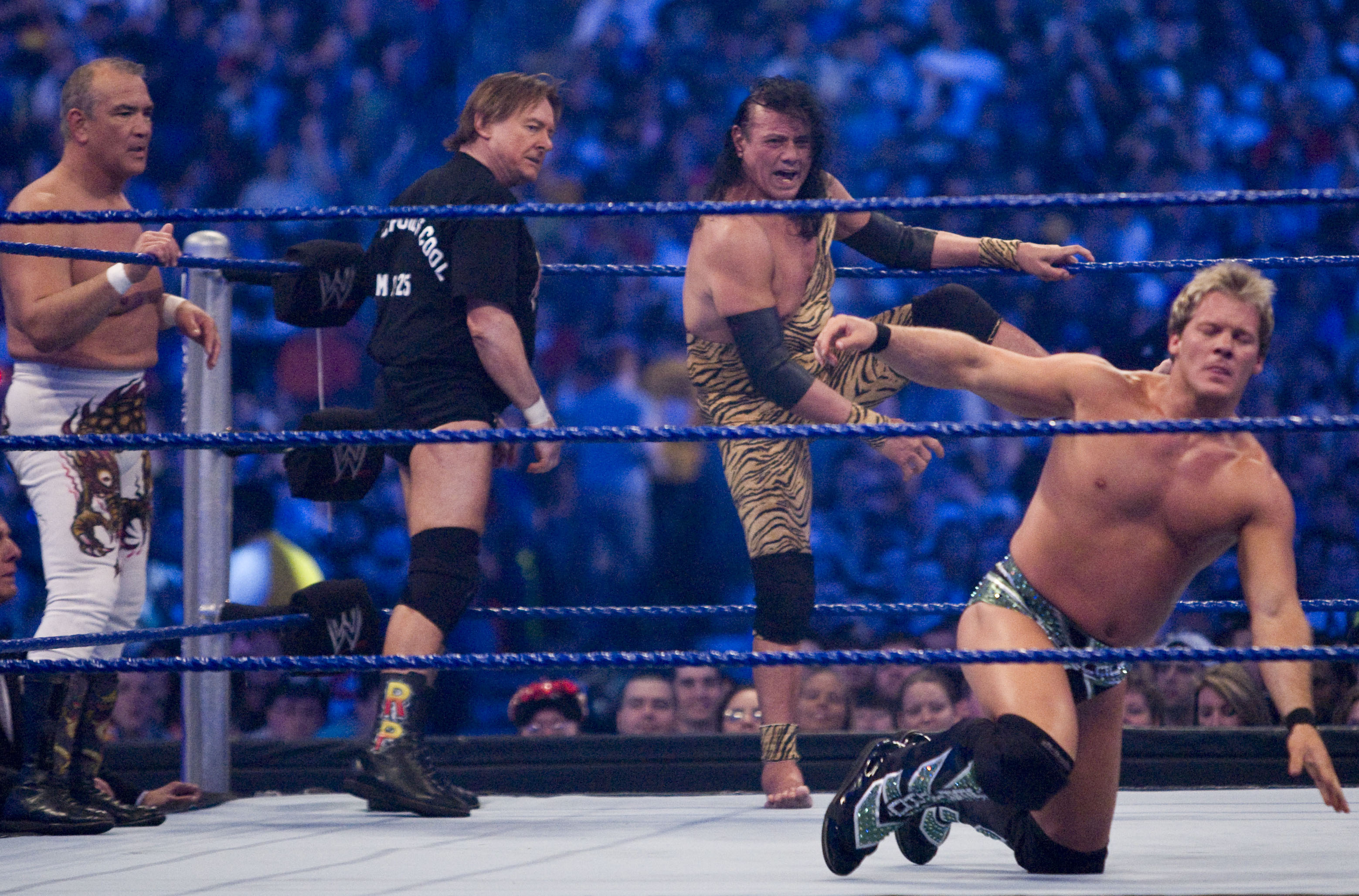 HOUSTON, TX - APRIL 5:  (L-R) Former professional wrestlers Ricky 'The Dragon' Steamboat and 'Rowdy Roddy Piper look on as Jimmy 'Superfly' Snuka steps into the ring to battle WWE Superstar Chris Jericho during  WrestleMania 25 at Reliant Stadium on April
