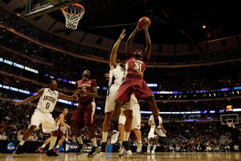 CHICAGO, IL - MARCH 20:  Chris Singleton #31 of the Florida State Seminoles rebounds against the Notre Dame Fighting Irish in the second half during the third round of the 2011 NCAA men's basketball tournament at the United Center on March 20, 2011 in Chi