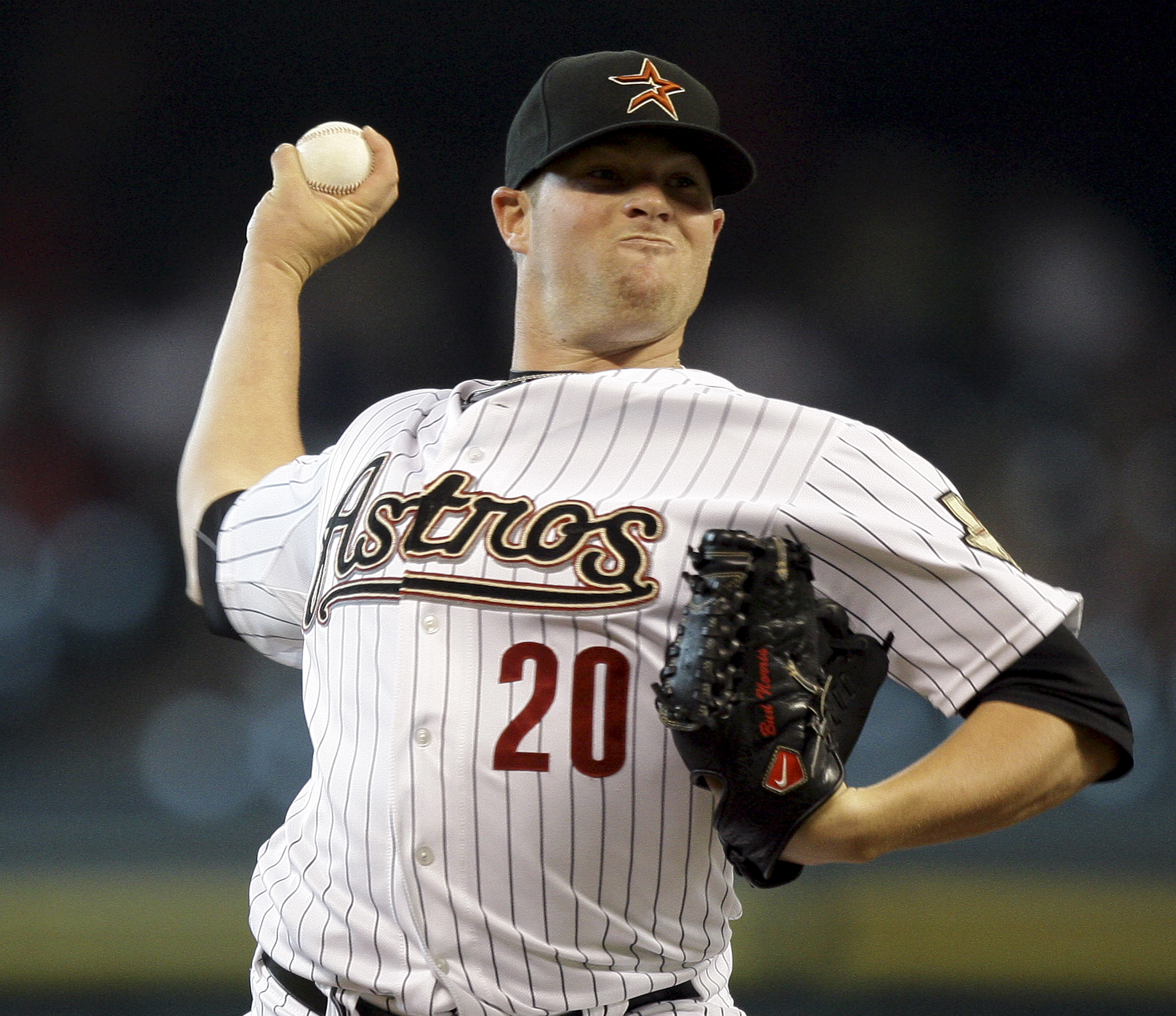 HOUSTON - JUNE 08:  Pitcher Bud Norris #20 of the Houston Astros throws against the St. Louis Cardibnals at Minute Maid Park on June 8, 2011 in Houston, Texas.  (Photo by Bob Levey/Getty Images)