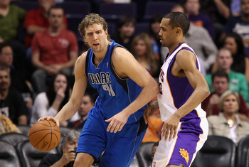 PHOENIX, AZ - MARCH 27:  Dirk Nowitzki #41 of the Dallas Mavericks handles the ball during the NBA game against the Phoenix Suns at US Airways Center on March 27, 2011 in Phoenix, Arizona.  The Mavericks defeated the Suns 91-83.  NOTE TO USER: User expres