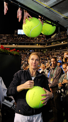 INDIAN WELLS, CA - MARCH 12:  Tennis legend Stefi Graf of Germany signs tennis balls after participating in Hit for Haiti, a charity event during the BNP Paribas Open on March 12, 2010 in Indian Wells, California.  (Photo by Kevork Djansezian/Getty Images