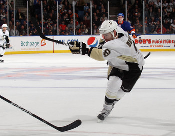 UNIONDALE, NY - APRIL 08: Pascal Dupuis #9 of the Pittsburgh Penguins skates against the New York Islanders at the Nassau Coliseum on April 8, 2011 in Uniondale, New York.  (Photo by Bruce Bennett/Getty Images)