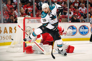 DETROIT - MAY 4:  Devin Setoguchi #16 of the San Jose Sharks attempts to screen goaltender Jimmy Howard #35 of the Detroit Red Wings in the first period in Game Three of the Western Conference Semifinals during the 2011 NHL Stanley Cup Playoffs on May 4,