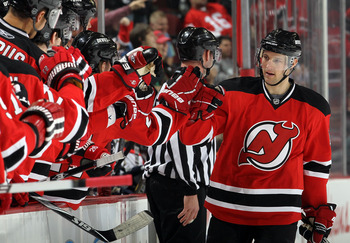 NEWARK, NJ - FEBRUARY 04:  Travis Zajac #19 of the New Jersey Devils celebrates his first period goal against the Florida Panthers at the Prudential Center on February 4, 2011 in Newark, New Jersey.  (Photo by Jim McIsaac/Getty Images)