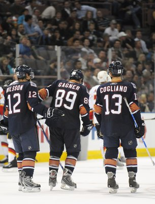 EDMONTON, AB - SEPTEMBER 30:  Known as the kid line, are Robert Nilsson #12, Sam Gagner #89 and Andrew Cogliano #13 of the Edmonton Oilers skate in a game against the Calgary Flames in the third period during a preseason NHL game on September 30, 2008 at